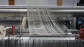 mechanized : weaving loom at a textile factory, closeup. industrial fabric production line. the camera is stationary. the damage to the equipment Stock Footage