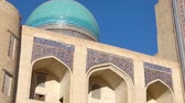 cami : Old historical building with arch and dome. Ancient buildings of medieval Asia. Bukhara, Uzbekistan