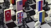 レスポンス : Symbols of the flags of the world on the chessboard. The concept of political game.