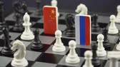 indépendance : Symbols of Russia and the China on the chessboard. The concept of political game. Vidéos Libres De Droits