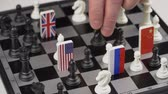 domínio : Politicians hand moves a chess piece. Conceptual photo of political game and strategy.