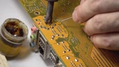 computer chip : technician electronic soldering and repairing computer chip Stock Footage