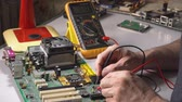 oscilloscope : electronics technician is testing a computer chip. PC repair Stock Footage