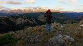 picture : Extreme Photographer Taking Picture Of Beautiful Nature Full Of Rivers And Trees From The Top Of Mountain During The Sunrise Stock Footage