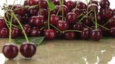 ne : Selective focus of two cherries and a bunch of cherries.
