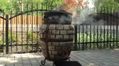 tandoor : Scorching, heating up the tandoor. Tandoor with fire. Stock Footage