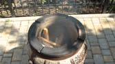 tandoor : Scorching, heating tandoor. Ignition of paper and loading pieces of wood.
