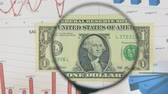 considering : Study of a banknote one dollar, increasing with the help of a magnifying glass. Stock Footage