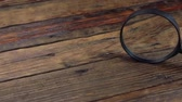 detetive : Magnifying glass on a vintage wooden table. Slider shot. Stock Footage