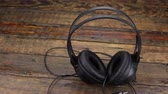 hacim : Panorama of headphones standing on a vintage wooden table.