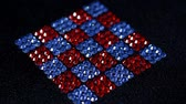 tela : Rotation of red and blue squares made of rhinestones.