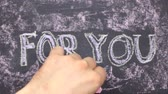 ваш : Word FOR YOU is written in chalk on a blackboard. Word circled in chalk.