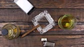aschenbecher : Camera crane, top view, modern wooden desk, glass of whiskey and cigar .
