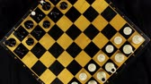 peones : Rotation of the chessboard with the figures arranged for the start of the chess game. Top view. 360 degree rotation