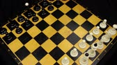 rotated : Chess pieces on a chessboard table. Panorama. Stock Footage