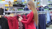 womens : beautiful girl in a clothing store Stock Footage