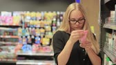 losyon : girl in the supermarket chooses cream