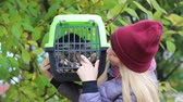 travel cage : girl holding a container with a cat Stock Footage