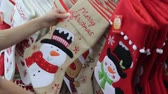 womens : Female hands touch Christmas decorations in the form of socks with drawings
