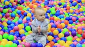 oyun alanı : little boy having fun on the playground with colored balls