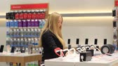 quality time : Girl examines smart watches in the store