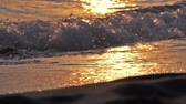 acqua frizzante : beach wave splashing macro in sunset slow motion