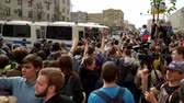 objection : RUSSIA, MOSCOW - JUNE 12, 2017: Rally Against Corruption Organized by Navalny on Tverskaya Street. The crowd applause accompanies a police bus with detained