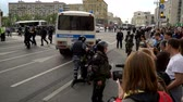 objection : RUSSIA, MOSCOW - JUNE 12, 2017: Rally Against Corruption Organized by Navalny on Tverskaya Street. Policemen harshly guide the detained young man to the bus Stock Footage