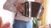 accordionist : the groom plays the accordion