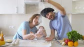 cooking : Happy Family is Cooking in The Kitchen. Dad Sifts Flour Slow motion.