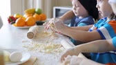 flour : Small kids make dough. Children play in the kitchen and get dirty in flour