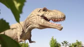 nagy : DINO PARK, MANAVGAT, TURKEY - MAY 15, 2017: Tyrannosaurus life size model of prehistoric animal in theme entertainment Dino Park. Stock mozgókép