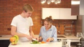 relaxation : Young couple preparing salad in the kitchen.