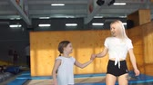 Two sisters bouncing in the trampoline park, Slow motion