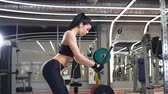 sağlam : Woman doing exercise at crossover machine in gym Stok Video