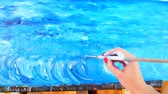 illustrateur : Attractive woman artist painting sea-scape in workshop