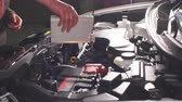 inspect : Pouring oil to car engine, close up. Stock Footage