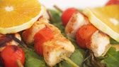 főétel : Close up of chicken kebabs served with tomato cherry and rosemary on frying pan.