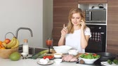 gospodyni domowa : Young positive girl, recently got married , learning to cook home made meal from fresh and healthful diet products. Wideo