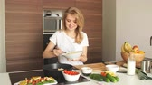 Pleasant young woman preparing dinner in a kitchen. Concept of healthy home cooking, culinary, healthy lifestyle.
