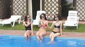 szolárium : Beautiful tanned womens legs in swimming pool.close up cropped photo.health, depilation concept