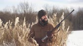 shotgun : happy cheerful hunter holding a rifle and looking aside. close up video Stock Footage