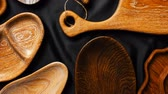 metalic : Rich variety of wooden empty cutting boards and plates on dark background. Mock up of dishes for restaurant serving