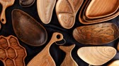 gıda maddeleri : Set of cutting boards on kitchen wooden utensils, plates and dishes made from oak, walnut and pine wood isolated on dark background.
