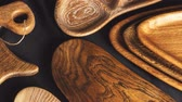 ferrugem : Showing growth rings. Design boards made of solid wood. Set of cutting boards and wooden dishes made from of valuable timber on dark background.