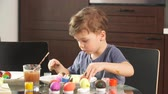 Little Boy Decorating Easter Eggs for Holiday. Easter celebration concept. Stock Footage