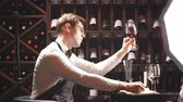 vinificação : Experienced sommelier possessing not only wine etiquette but also wine tasting skills enjoying taste and flavor of noble beverage. Stock Footage