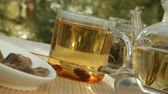 tea : Woman mixes glass of tea outdoors