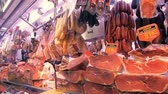 serrano : BARCELONA, SPAIN - JUNE 10, 2016: Market stall with expensive spanish ham Jamon at La Boqueria market in Barcelona