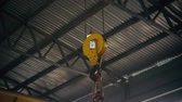 tons : Factory overhead crane inside a factory building.